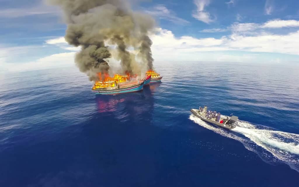 illegal fish boats burning in Palau aerial drone shot