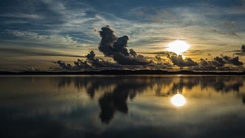 Sunrise in Palau calm water clouds time-lapse